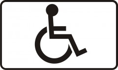 Plate informing about a place dedicated for a vehicle of a handicapped person with decreased physical capableness
